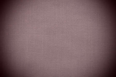 texture of natural red or burgundy fabric close-up. The texture of the fabric is made of natural cotton or linen textile material. Canvas background. Smooth surface, smoothed fabric. Dark vignetting Stock fotó
