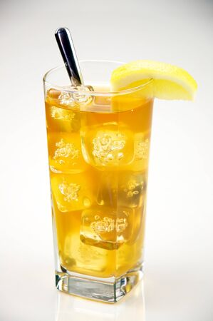 lemon wedge: Pitcher of Iced Tea with a Glass of Ice Tea