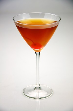 sweet vermouth: A classic rob roy cocktail with whiskey, bitters, sweet vermouth and garnished with a cherry