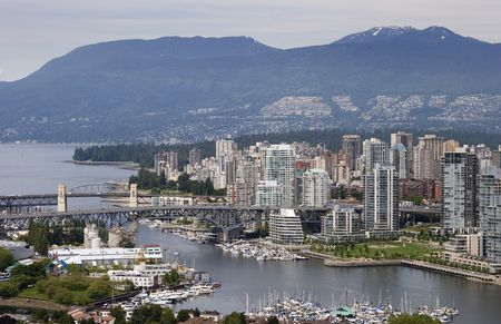 columbia district: A view of Vancouver, British Columbias West End. False Creek and English Bay are in the foreground, the Coastal Mountains in the background.
