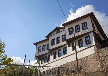 Traditional old ottoman village house and blue sky