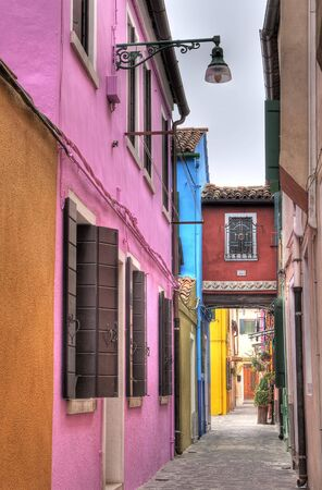 Colorful alley in Burano, Italy. Stock Photo