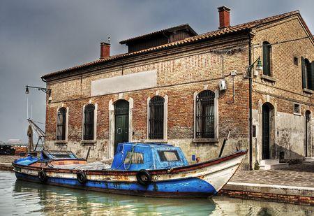 Old brick warehouse and cargo-boat. Stock Photo - 6227759