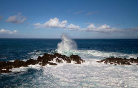 Waves breaking on Madeiras north coast. photo