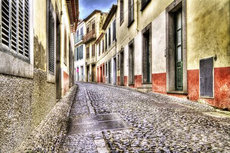 Old cobblestone street in Funchal, Madeira.
