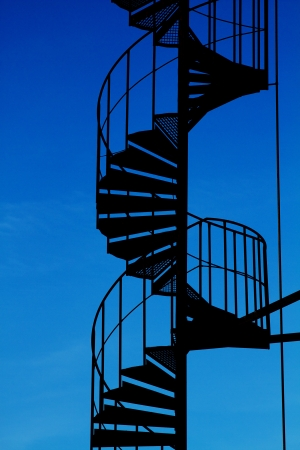 Spiral staircase silhouette. Stock Photo