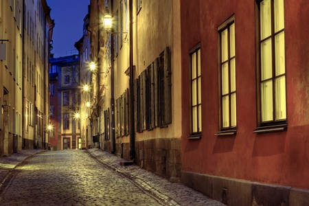 city alley: Old Town street illuminated at night. Stock Photo