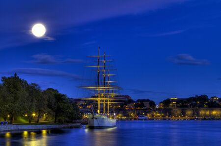 Old ship in moonlight. Stock Photo