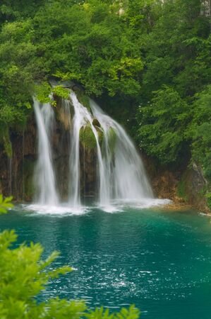 Beautiful waterfall in lush surroundings.