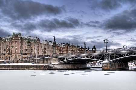 Old bridge and buildings in winter.