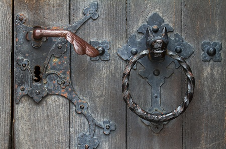 antique keyhole: Vintage door with door knocker.
