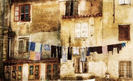 Laundry drying outside in an old european town. Stock Photo - 12715299