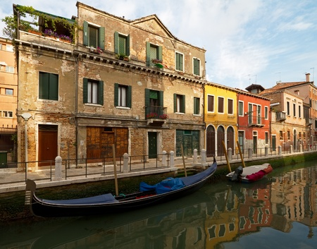 Canal with gondola on Murano, near Venice.