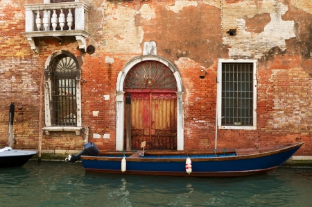 Ancient brick building on a canal in Venice. Stock Photo - 14806014