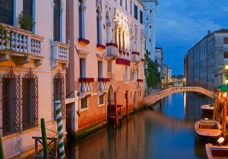 Magnificent buildings at a canal in Venice at night