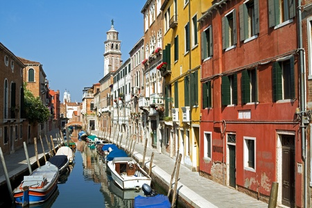 Venice in summer with canal and old beautiful buildings. Stock Photo