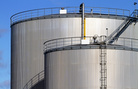 oil refinery: Industrial fuel storage tanks. Stock Photo