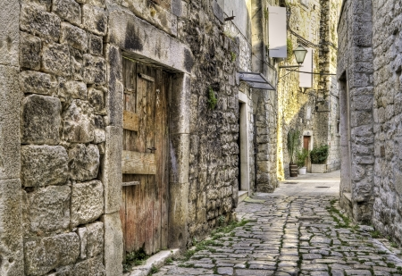 Ancient cobblestone street and buildings in a medieval town in Croatia. photo