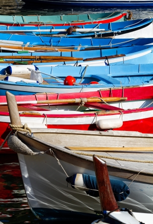 Row of colourful rowboats used for fishing.