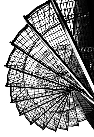 Black and white image of a spiral staircase  photo