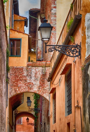 Medieval alley in the city of Pisa in Italy  photo