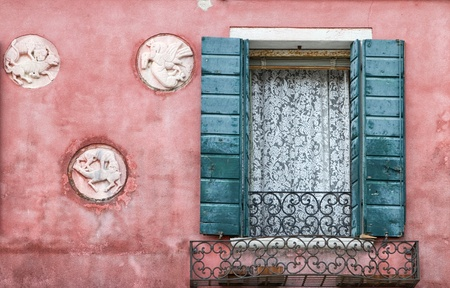 Window with lace curtains and shutters on pink vintage facade Stock Photo - 20988135
