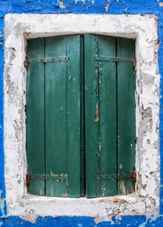 Rustic window with green shutters Stock Photo - 21160255