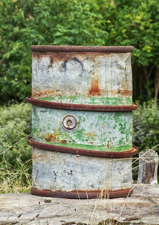 Old rusty steel barrel for fuel storage  photo