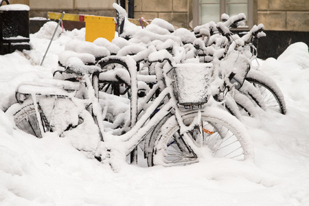 Bikes covered with snow in winter  photo