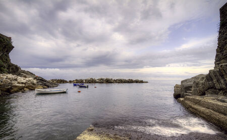 Rocky seascape with small boats  Stock Photo