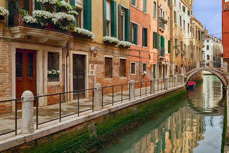 Canal, bridge and buildings in Venice  photo