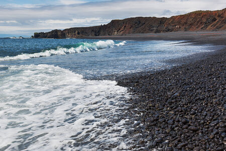 Scenic black beach and Atlantic ocean in Iceland  photo