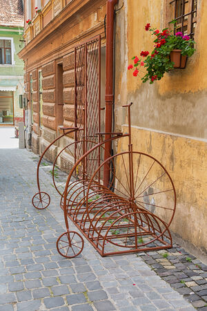 Vintage style bicycle bike rack on cobblestone street  photo