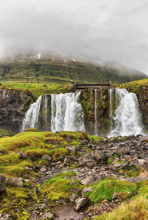 Landscape with waterfall in summer. photo
