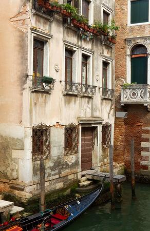 Backyard in Venice with parked gondola. Stock Photo