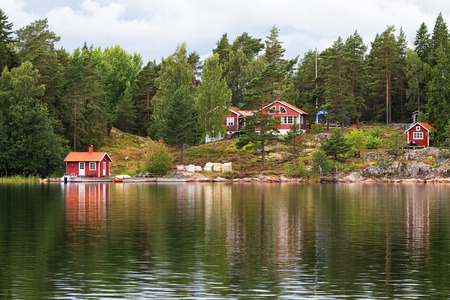 Typical red summer cottages in Sweden.