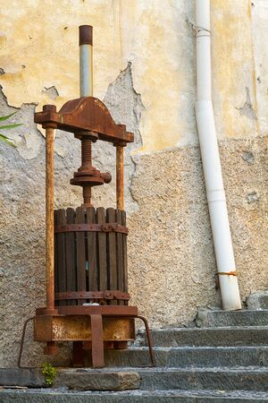 extracting: Antique olive press for extracting olive oil.
