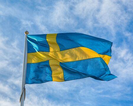 Swedish blue and yellow flag.