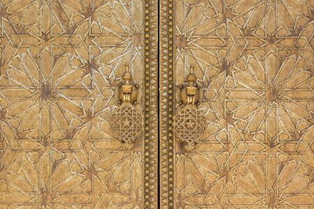 intricate: Oriental golden door with intricate pattern.