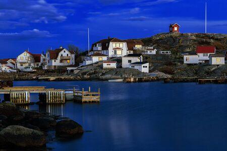 the white house: Idyllic fishing village on the Swedish west-coast at night.