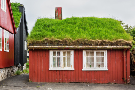Red cottage with thatched roof in Torshavn on Faroe islands.