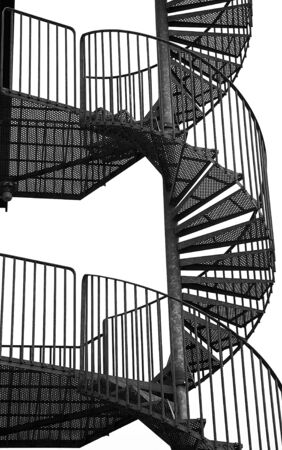 metal handrail: Close-up of winding spiral staircase, black and white image. Stock Photo