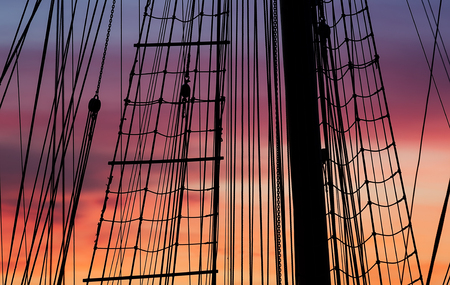 vintage ship: Silhouette of a vintage ship at sunset. Stock Photo