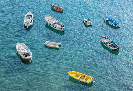 fishingboats: Aerial view of fishing-boats anchored in the mediterranean sea.