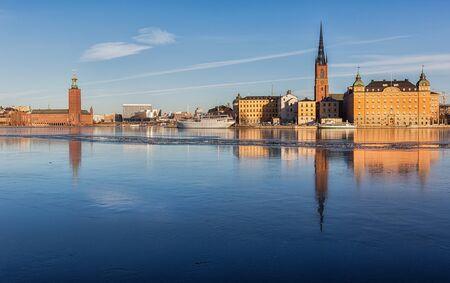sweden winter: View over Stockholm Ciy-hall and Riddarholmen island.