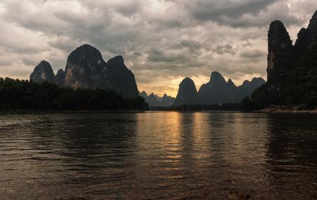 Sunset on Li river in China, beautiful karst landscape.