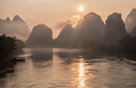 Li river in mist at sunrise. Yangshuo, China.