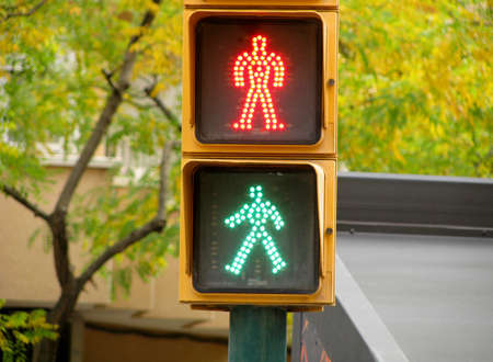 Pedestrian traffic lights green and red light photo