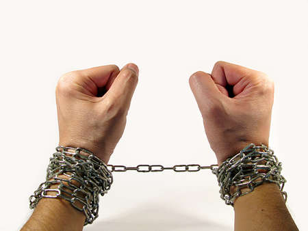 chained hand, the concept of being tied to something and slavery Stock Photo - 16600474