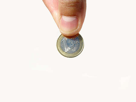 hand holding a one euro coin Stock Photo - 16600468